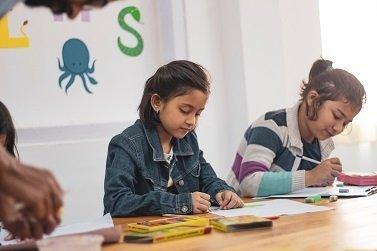 two-girls-doing-school-works